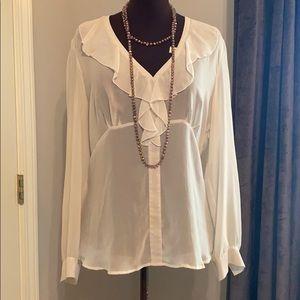 Sheer white ruffled blouse